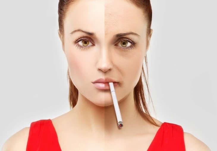 Лицо курильщика страдает от акне и морщин